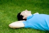 3440589-young-man-lying-on-the-grass